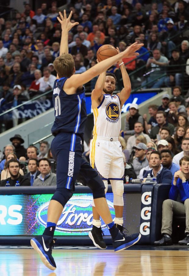 DALLAS, TX - JANUARY 03: Stephen Curry #30 of the Golden State Warriors takes a shot against Dirk Nowitzki #41 of the Dallas Mavericks at American Airlines Center on January 3, 2018 in Dallas, Texas. NOTE TO USER: User expressly acknowledges and agrees that, by downloading and or using this photograph, User is consenting to the terms and conditions of the Getty Images License Agreement. (Photo by Ronald Martinez/Getty Images)
