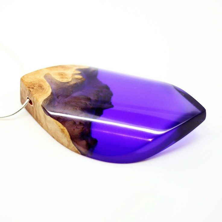 Stunning purple pendant made using wood and resin. Polished to a smooth glossy…