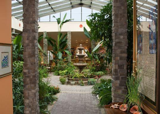 Indoor atrium homes each garden atrium home has a for Homes with atriums floor plans