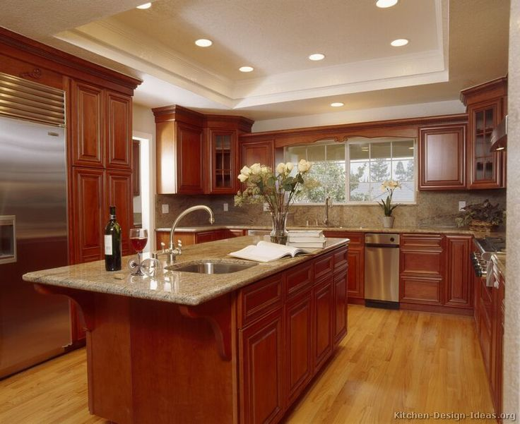 Traditional Medium Wood Cherry Kitchen Cabinets (Kitchen Design Ideas.org)