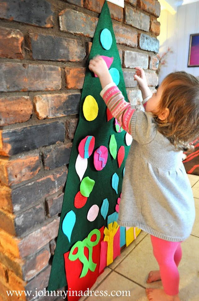 Felt Christmas Tree. Put up and permanent felt tree with attached bulbs and then give them extra ones to attach with Velcro. Take away the detachable ones when done and still have a cute decoration.