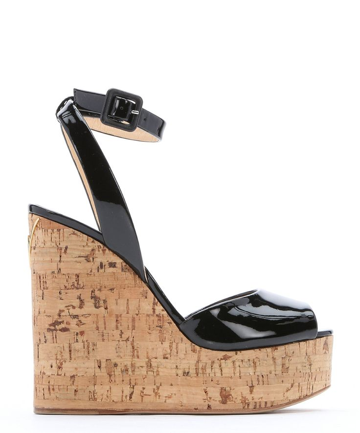 The Giuseppe Zanotti black patent leather 'Roz' cork wedges at Bluefly.