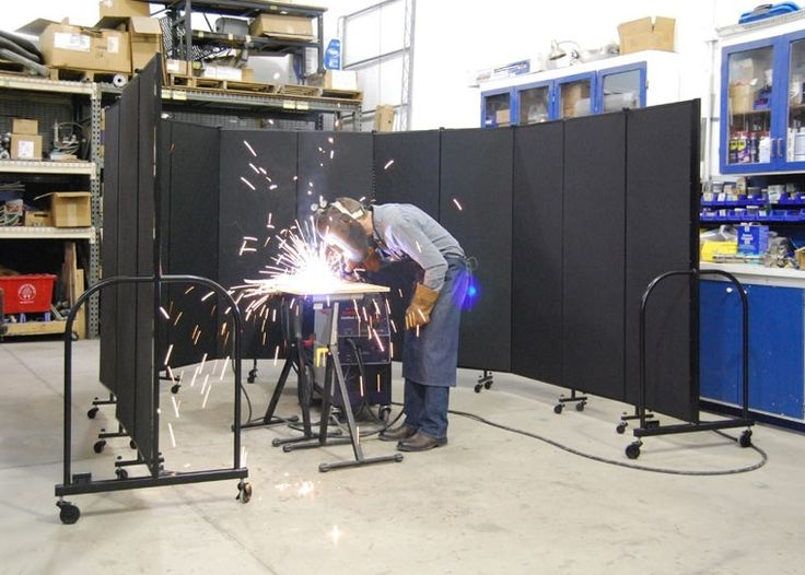 Portable welding screens with Sandel Fire Barrier fabric keep sparks safely surrounded.