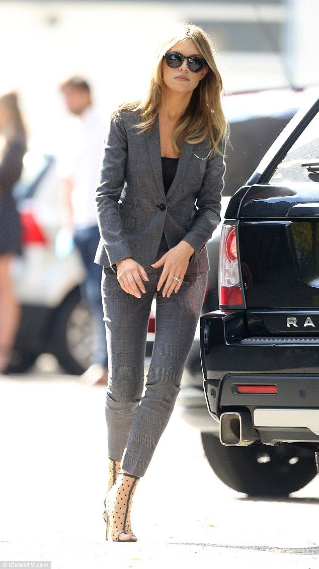 Smartening up: Abbey Clancy, 29, was dressed to impress in a form-fitting grey suit jacket and matching trousers - September 26, 2015