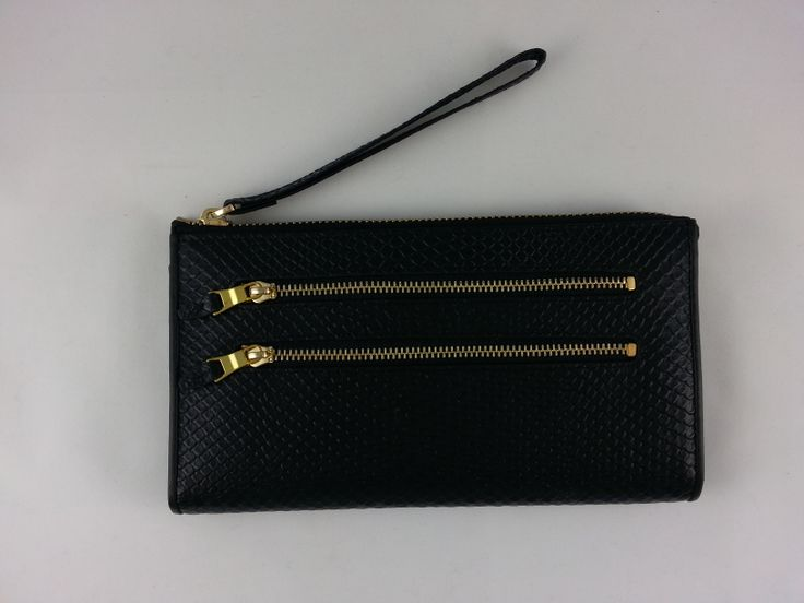 Oli & Ole black Isabella wallet with zippered wrist strap.  Has 2 zippered coin compartments in front & note and card internal compartment. Throw in your essentials and use as a clutch during the evening
