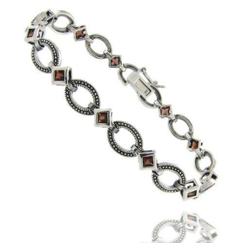Sterling Silver Simulated Garnet Oval Link Bracelet LEAH HANNA. $39.99. Save 56%!