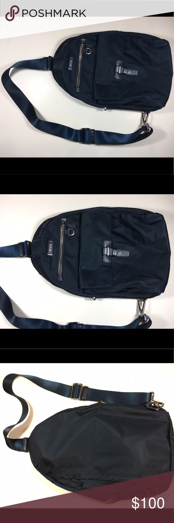 Tumi Navy Cross Body Backpack Brand- Tumi Color- Navy Style- Cross body backpack Condition- pre-owned, good condition, one mark on the inside, see last photo Tumi Bags Backpacks