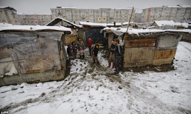 Harsh living: The bitter cold weather is difficult for the residents to endure in their make-shift homes