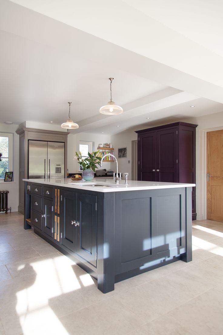 Large island unit. Freestanding Larder cupboard and built in Sub-zero fridge/freezer. Surrey Kitchen