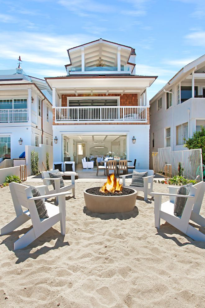 California Beach House with Crisp White Coastal Interiors. Just fine for a proud beach house dad and his family.