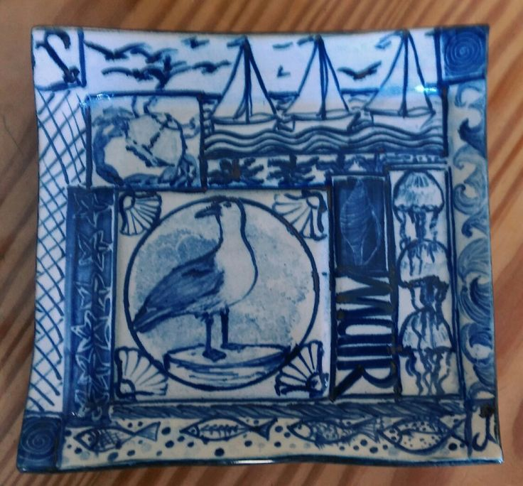Ceramic dish. Sea themed blue and white decoration.