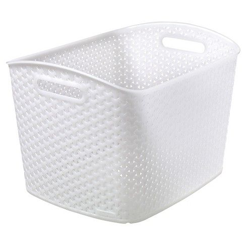 Forget clunky plastic storage bins and go the stylish route with Y Weave Extra Large Storage Bin - White - Room Essentials™. This classic basket design fits in with your existing home decor and works well for storing everything from magazines to craft supplies to linens and laundry.