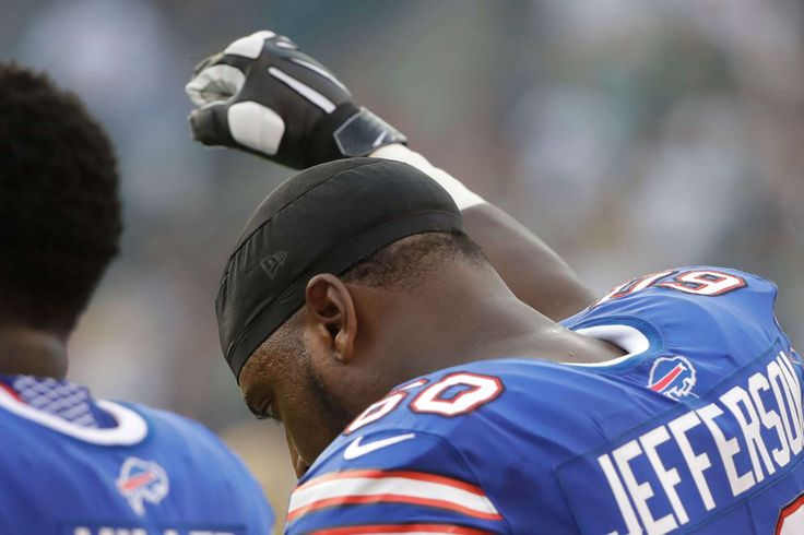NFL players' national anthem protests   -  Buffalo Bills offensive tackle Cameron Jefferson raising his fist during the national anthem before an preseason football game against the Philadelphia Eagles in Philadelphia. Jefferson says he gained the courage to raise his fist in protest during the anthem once he saw Chris Long hug Eagles teammate Malcolm Jenkins on the opposite sideline on Thursday
