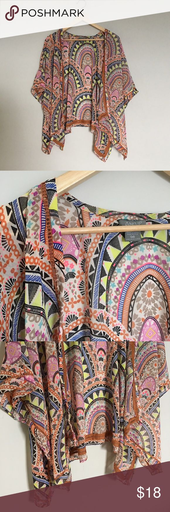 "Angie Sheer Boho Kimono Top Neon Geometric Print Open boho kimono top from Angie in a gorgeous neon geometric pattern against a cream background. Featuring rust cotton eyelet trim detail and a great drape. Appx 23"" long from top of shoulder and appx 39"" wide when laid flat. Angie Tops Blouses"