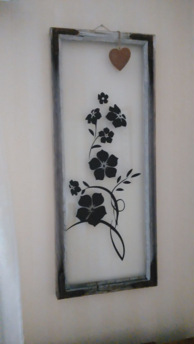 Old window & frames with a design sticker. Easy to do and looks nice.
