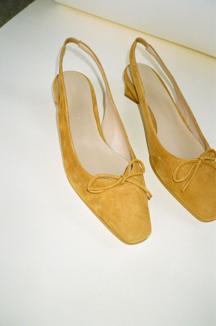 They're called oasis for a reason. Soothe your soul with these mustard slingbacks that pair perfectly with black trousers and a chunky knit.  By ABOUT ARIANNE    Made in Spain    European sizing    Fits true to size    --  Size down if you are in between sizes  36 fits US 6  37 fits US 7