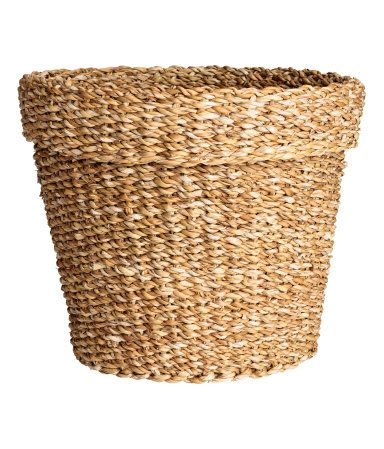 Beige. Large storage basket in thick, braided seagrass. Height 10 in., diameter 12 1/4 in.