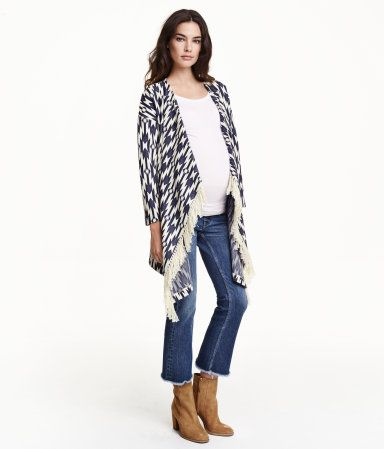 Dark blue/patterned. Jacquard-knit cardigan in a cotton blend with imitation suede fringe at front of hem. Dropped shoulders, long sleeves, and no buttons.