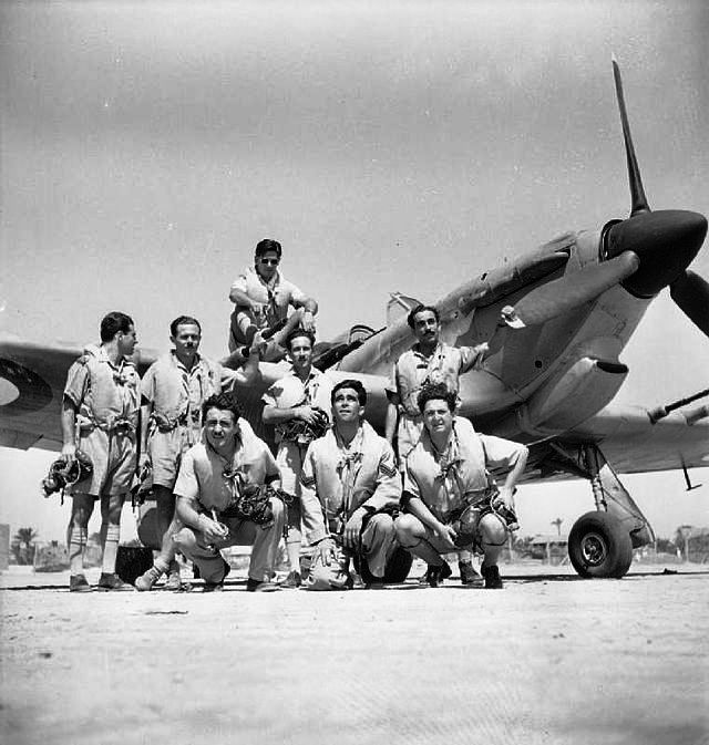 Pilots of No 335 Squadron RAF pose in front of one of their recently received Hurricane Mk IIc (trop) at Dhekeila, Egypt, in August 1942. The pilots began operations over the Western Desert, where they operated continuously until later the year, participating in convoy protection, bomber escort and ground attack roles.