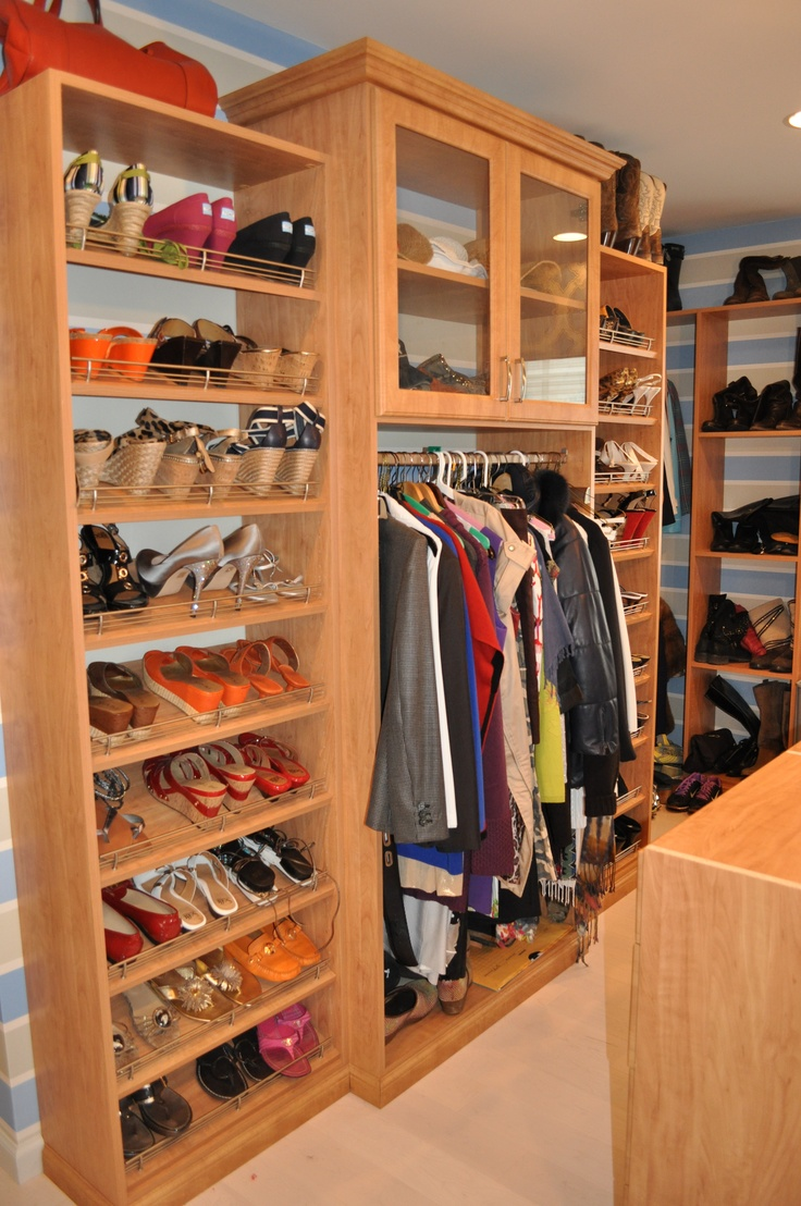 Floor to ceiling slanted shelves for shoes plus some for A 1 custom cabinets