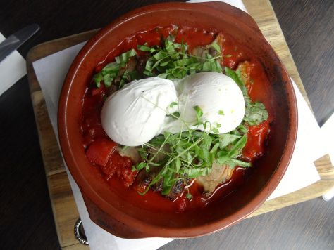 Lamb Shakshuka: smoked lamb mixed with spiced and richly flavoured tomato and red capsicum sauce, topped with two poached eggs. From Third Wave Cafe, Melbourne.
