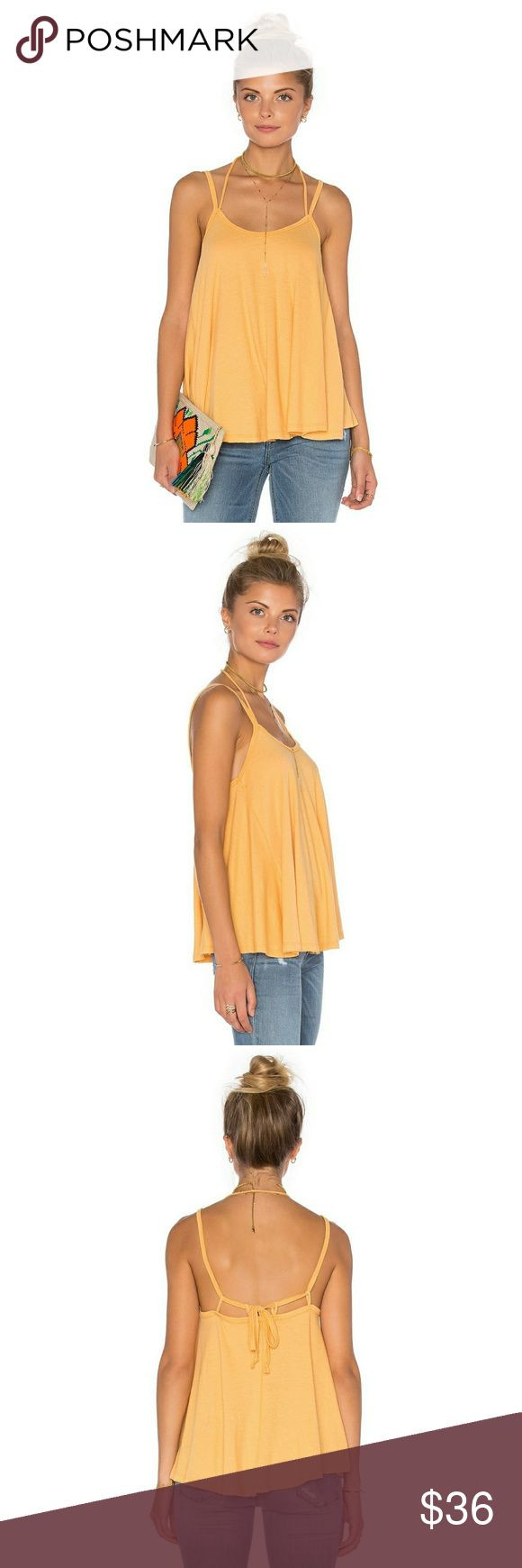 We the Free People Flowing Tank Top w Tie Back We the Free People So in Love Tank  New with tags! Size Medium  This is a wide & flowy A line tank which has straps that tie on the back. Color is mango.  Save 30% on any bundle of two or more items plus FREE Shipping on all bundles! Check out my closet - most of the items I sell are new- great gift ideas! Offers welcome too 💙 Free People Tops Tank Tops