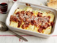 This three-cheese-stuffed Manicotti is made with paper-thin crepes and covered in a homemade mushroom meat sauce.