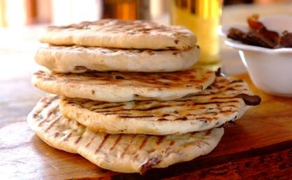 Planning a #braai #picnic? Your friends will go mad for these easy Biltong Flat Breads. Roll out the dough into circles in advance, and layer them with sheets of wax paper in a plastic box, ready for the coals. #eatoutfestival