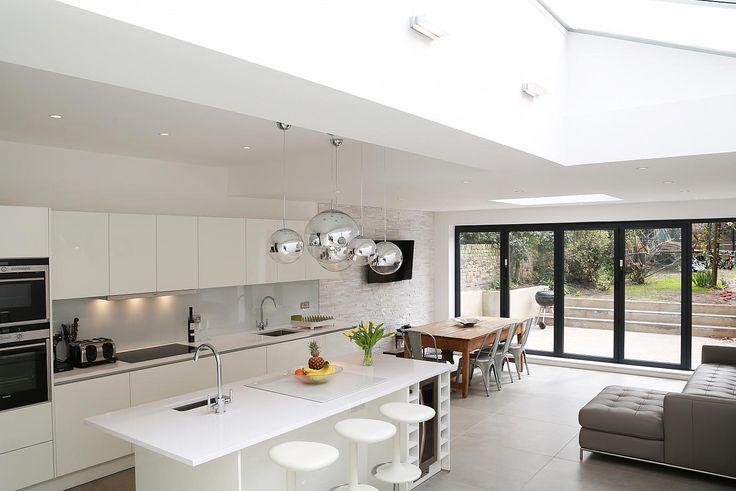 White high gloss lacquer kitchen island design.