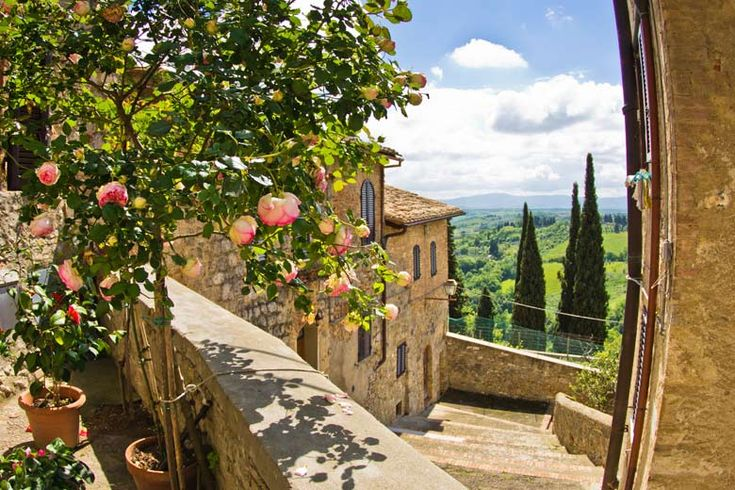 San Gimignano, Tuscany, set amid rolling vineyards | Tuscan treats - A brief guide to #Florence, #Siena, #Pisa and more | Weather2Travel.com #travel #italy #tuscany