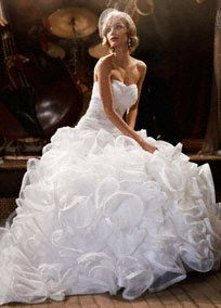 The height of Hollywood glamour, this unique and luxurious organza ball gown is extraordinary!  Skirt construction offers the classic ball gown shape a clean and modern twist.  Heavily embellished waistband, delicately assembled, emphasizes the waist without losing the princess look and feel.  Sweetheart neckline is flattering for every woman!