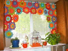 Love this curtain using a simple flower pattern...link for flower pattern available. I wonder if this could be made with doilies? They'd be easy to dye or color and could be easily put together. Tie them on the rod with ribbon.