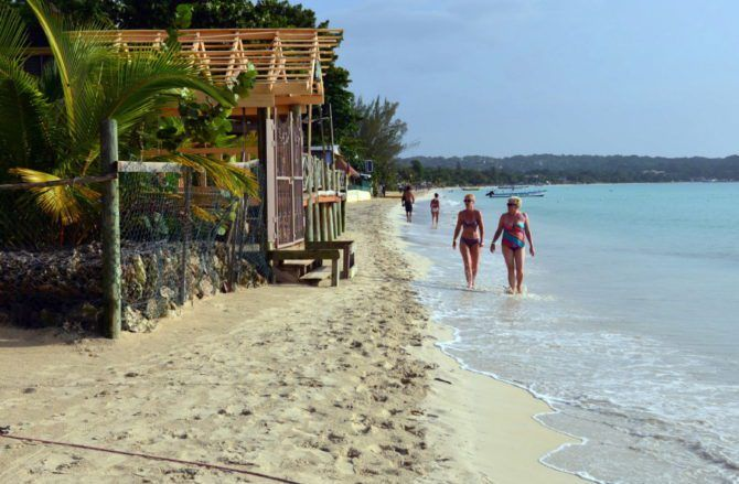 Island vacations still possible after hurricanes FILE - In this Sept. 14, 2014, file photo, sunbathers walk along a badly eroding patch of resort-lined crescent beach in Negril in western Jamaica. While some islands in the Caribbean were hard-hit by this season's hurricanes, others were relatively ... http://readr.me/fep4j