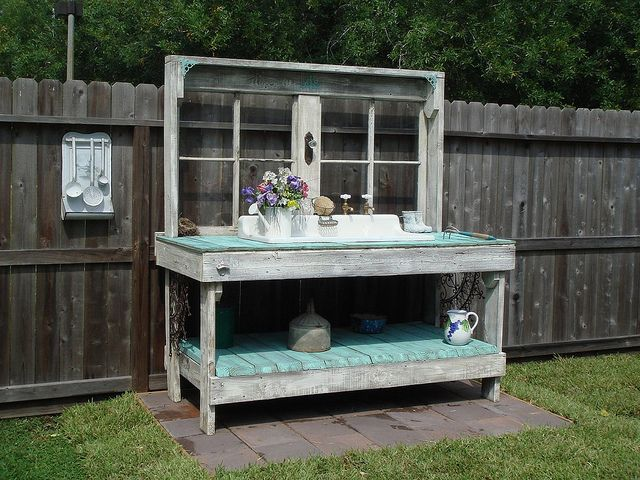 Potting bench that my awesome husband made for me! It's made from reclaimed wood (our old deck), a vintage farmhouse sink, antique windows, and some Victorian hardware accents and running water.  So cool!  Check out our Flickr photo link to see this project and more of our yard art.