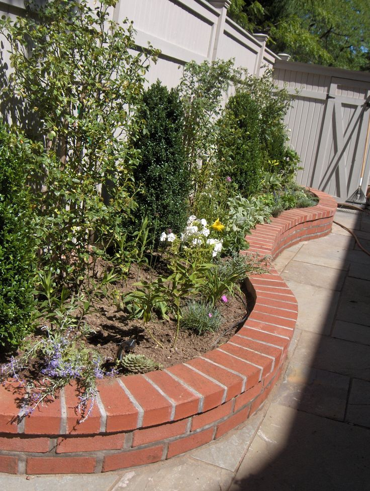brick wall garden backyard flower bed buildouts