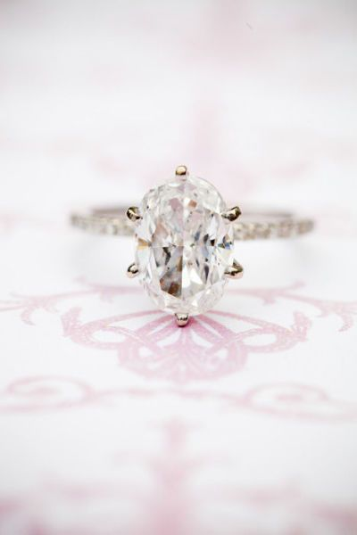 Oval-cut diamond ring: http://www.stylemepretty.com/2016/11/23/signs-hell-propose-this-holiday-season/ Photography: Vallentyne - http://www.vallentynephotography.com/