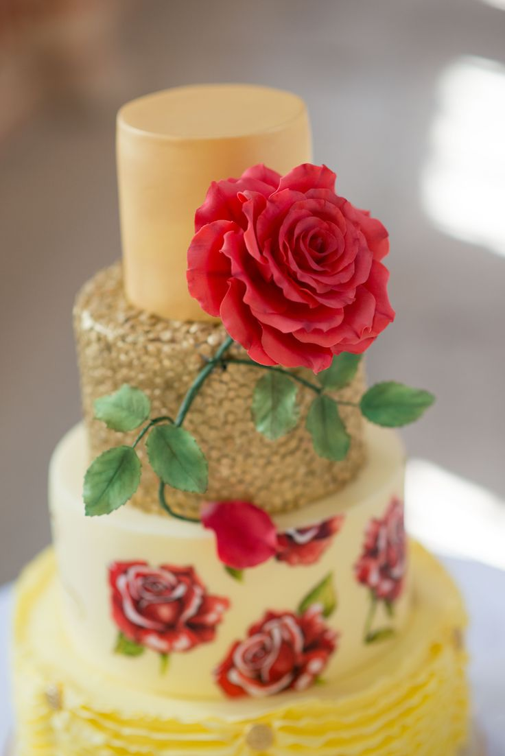 Hand painted Beauty and the Beast themed wedding cake with sugar enchanted rose and gold sequins.