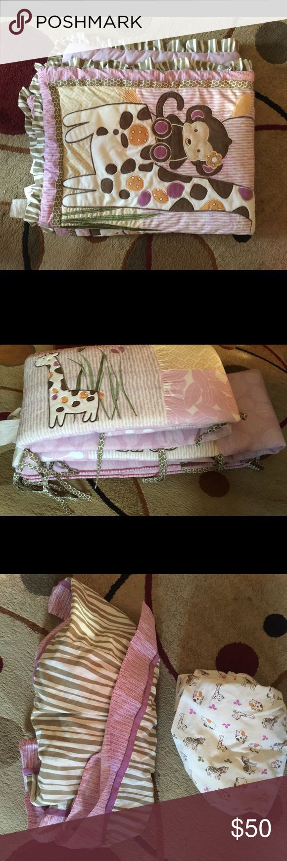 Baby crib set Selling baby crib set, used GREAT condition.  Cocalo Jacana bedding set.  -Quilt -dust ruffle -diaper stacker -fitted crib sheet -one wall hanger -bumper Other