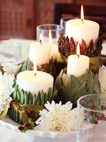 Put rubber bands around pillar candles. Insert beans or asparagus under the bands. Cover bands with pretty satin ribbon. Cover plate with mums!