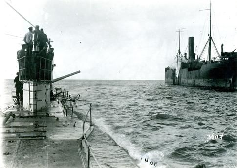 U-Boats ~ WWI ~ A view of the sinking British freighter SS Parkgate after a torpedo hit from the German submarine U–35 laying alongside the Parkgate.~ BFD