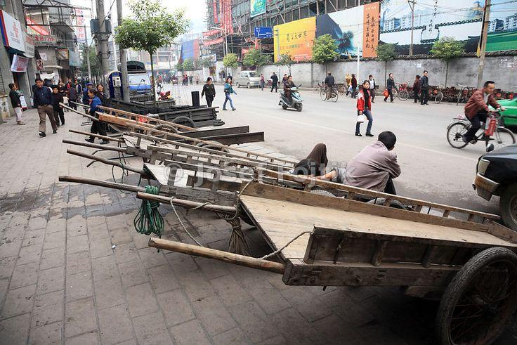 Push cart drivers waiting for a job, Fenghuang town, Hunan, China