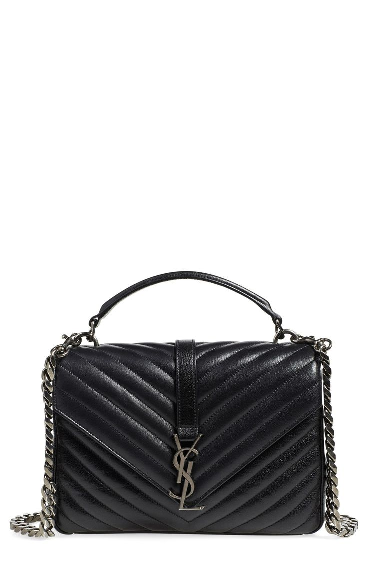 Gorgeous stitching and an oversized curb chain create this iconic style that stands out in classic black leather.  Adding this shoulder bag to the wish list!