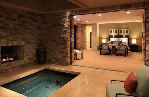 Beautiful master bedroom with indoor jacuzzi.