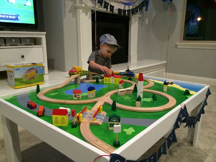 DIY train/lego board. One side is covered with lego base and the other side has is painted for a wooden train.