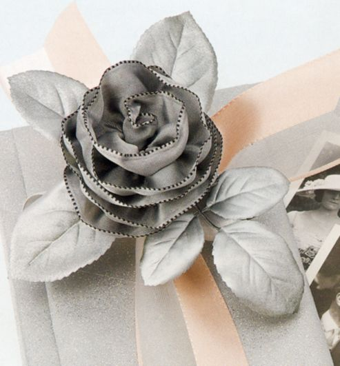 How to make a rose flower out of ribbon. Simply, use a wire ribbon; and, through the process of a few steps, create a rose flower.