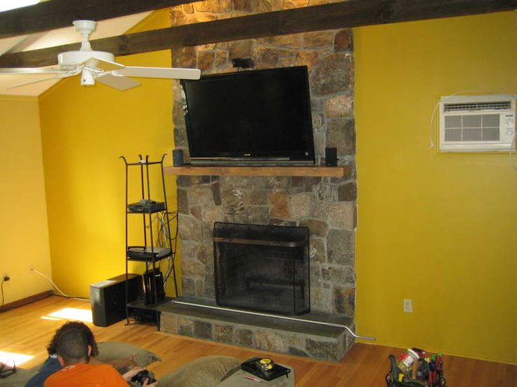 And No TV Mounting Over Fireplace With Yellow Walls
