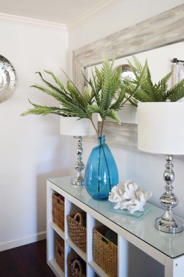 I love all the colorful glass vases you can find at HomeGoods! They make such a great design statement, and they are really affordable.  Sponsored Pin.