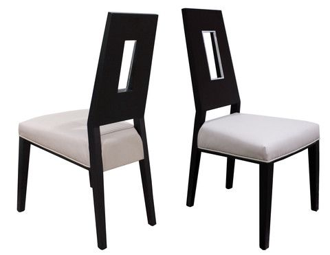 The Costa Chair is a modern detailed dining chair. Available in two finishes, wenge and white lacquer, this chair is truly unique. The bonded leather seat is extra cushioned for extra comfort. The back of the seat features a rectangular cutout with metal accents.