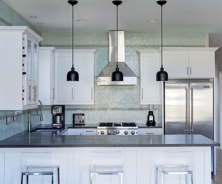 Unique and urban kitchen design with tiled walls and rustic chic lighting. From 1 of 10 projects by Lugbill design, discovered on Porch.com