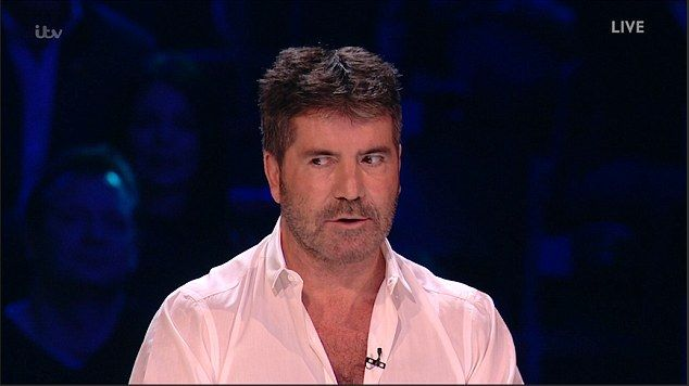 Oh dear:Simon Cowell fell foul of the anxious atmosphere at The X Factor live show as he accidentally attempted to send home his own act Gifty Louise during the judge's decision on Sunday night's show